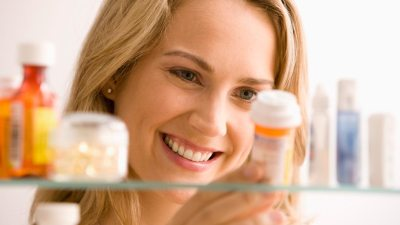 Woman with ADHD perusing medication to help her focus at work
