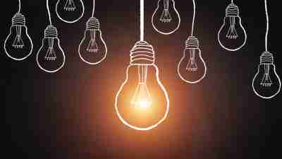 Illustration of light bulbs symbolizing big ideas in career of ADHD adult