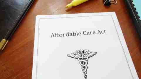 Copy of affordable care act on table, a document that might be good for ADHD treatment
