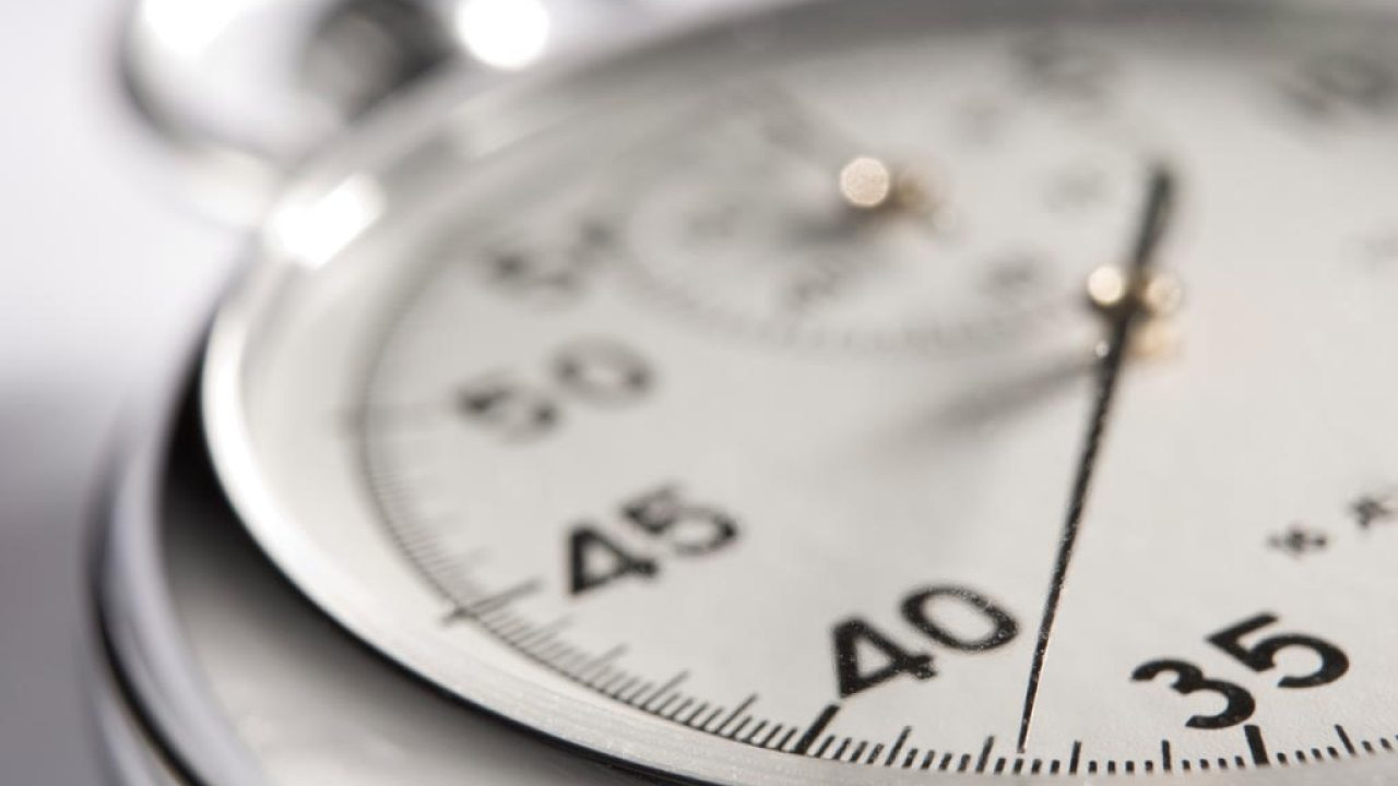 Close up of stopwatch signifying the way boredom stretches time for ADHD people
