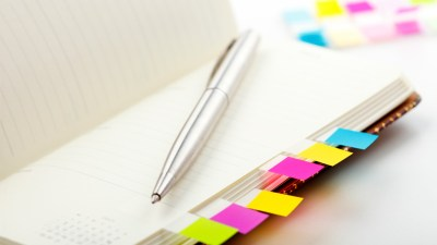 Planner belonging to person with ADHD with brightly colored bookmark stickers