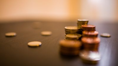 Change stacked up on table by ADHD person trying to save money