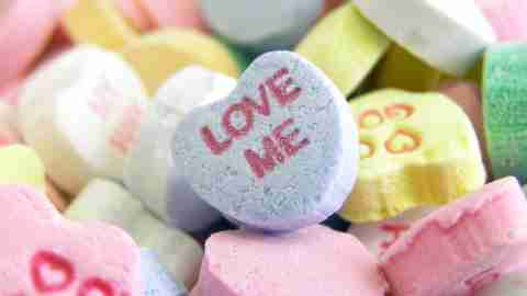 Candy hearts which say Love Me because ADHD is not the cause of adult ADHD breakups