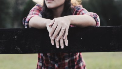 Avoid marital conflict like this ADHD woman on the fence with wedding ring