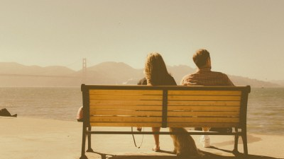 Man & woman on bench have relationship problems