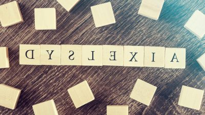 "Word ""Dyslexia"" spelled out in blocks backwards"