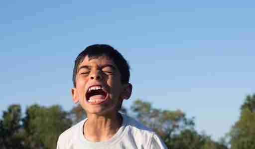 Boy with ADHD having meltdown and screaming outside