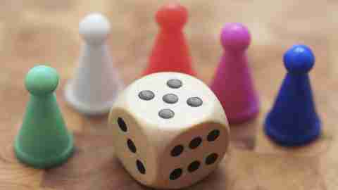 Close up of dice and game pieces belonging to child with ADHD