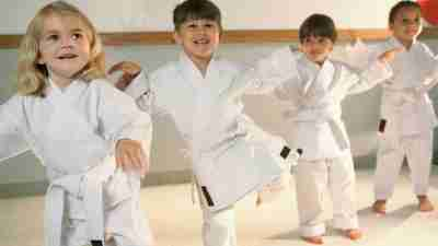 Children with ADHD practicing martial arts in studio