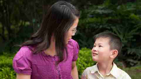 Mother explaining diagnosis to son with ADHD outside