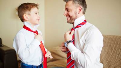 A father and son put on beck ties