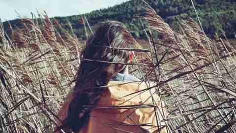 Teen girl with ADHD walking through windy field