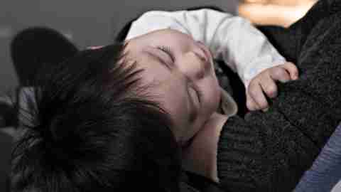 Positive Parenting Strategies: Child in Mother's Arms