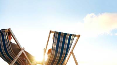Chairs on a beach, a relaxing vacation for a mom experiencing burnout