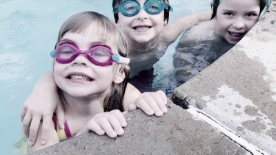 Kids at ADHD summer camp learning social skills while playing in pool