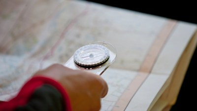 Person with compass and map orienteering, a good activity for kid with ADHD