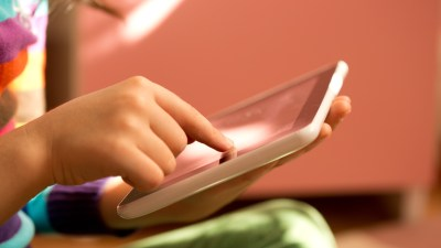 Girl with ADHD using iPad to access social skills apps