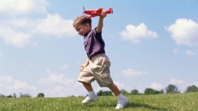 A preschooler with ADHD, running around a field