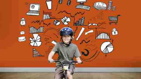 A boy riding a bike to help himself burn energy and focus