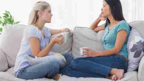 A mom of a child with ADHD has coffee with a friend who understands her child's challenges to support one another.