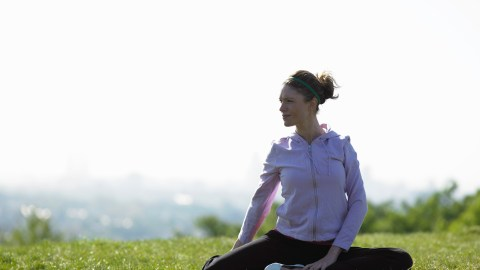 Young woman doing yoga, since physical activity is common advice for teens