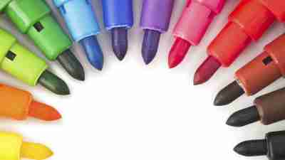 A circle of colored markers often used as ADHD organizational tools