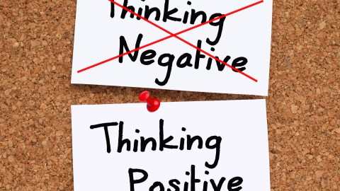 "The words ""thinking negative"" crossed out by someone diagnosed with ADHD"