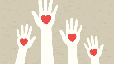 Hands of people diagnosed with ADHD, with red hearts in the palms