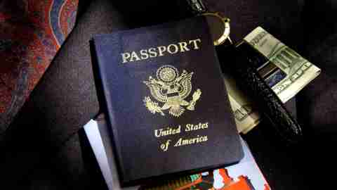 A passport and money, gathered together in accordance with common travel tips