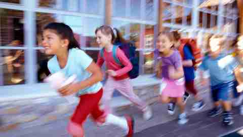Children running outside the classroom to better manage their behavior in class