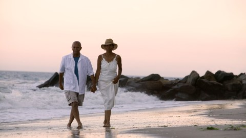 A couple with ADHD invests in their marriage with a walk on the beach.