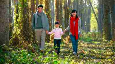 A family takes a walk together in the woods, one way to stop anxiety naturally
