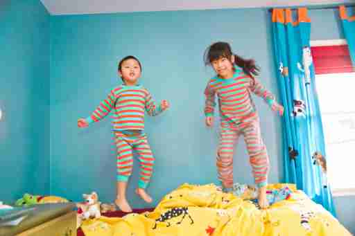 Kids with combined-type ADHD expend some energy jumping on the bed.