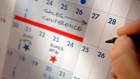 A calendar helps an event planner with ADHD manage dates.