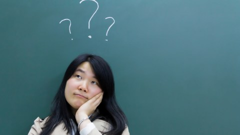 ADHD Woman wit blackboard question marks
