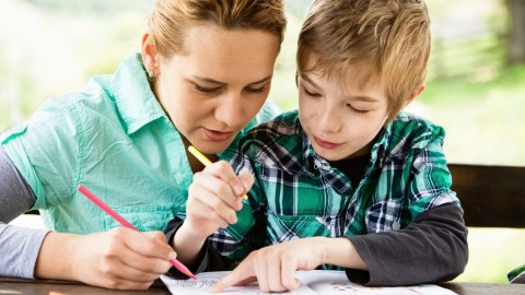 Mother and son working on a coloring book and discussing the side effects of his ADHD medication