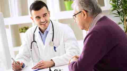 Doctor explaining the side effects of ADHD medications to his senior patient