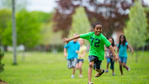 Boy running through a field, without side effects from his ADHD medication
