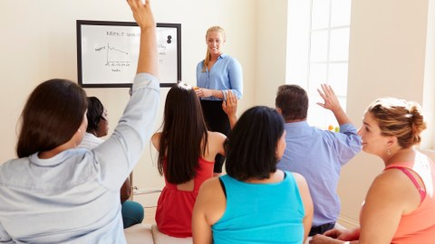 A group of people attend a meeting of an ADHD weight loss support group