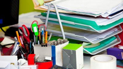 Lots of papers on a desk can be restricted by placing papers where they need to end up when you get them.