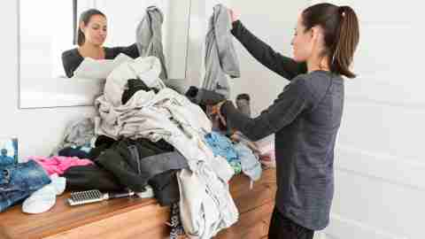 "A woman is sorting clothes thinking, ""my life is a mess."""