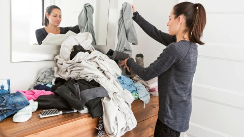 """A woman is sorting clothes thinking, """"my life is a mess."""""""