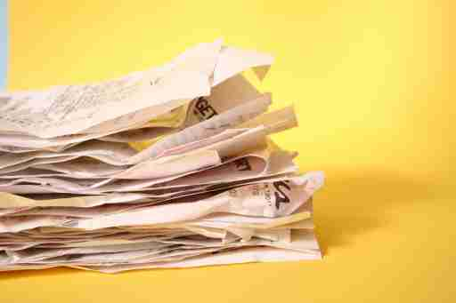 A pile of receipts is taken out of pockets and added to the mail sorting pile each day.
