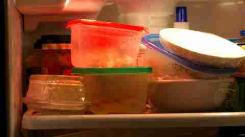 A messy pile of Tupperware in a refrigerator belonging to an ADHD home