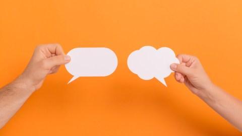 Question bubbles held up at a parent-teacher conference