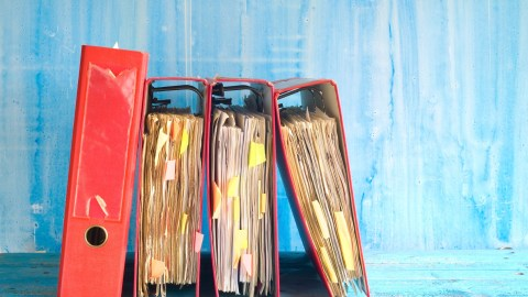 Binders full of papers and post-its — these could be replaced with assistive technology.