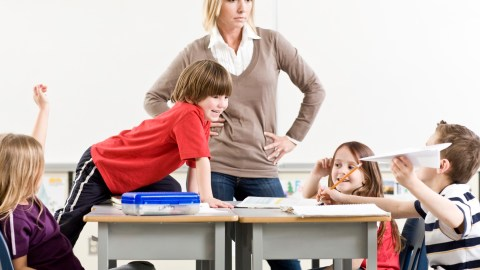 A teacher observing students to help with medication monitoring