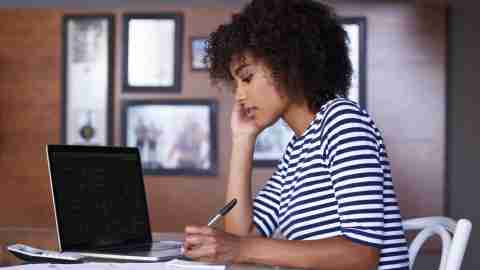 Woman working at a desk, giving herself positive affirmations