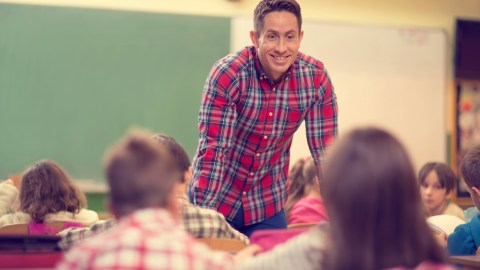 A teacher talks to his class about language processing disorders