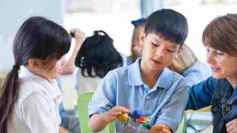 Children with language processing disorders play with blocks